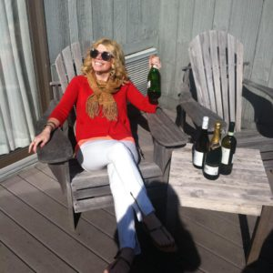 A shot of me in Montauk in the sun with champagne...couldn't be happier!