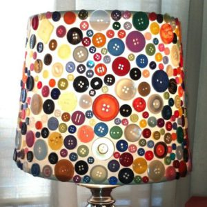 Take an old lamp shade and glue a bunch of buttons on it.