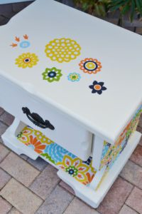 Furniture - paint it all white and then allow your kids to create their own artwork on it.